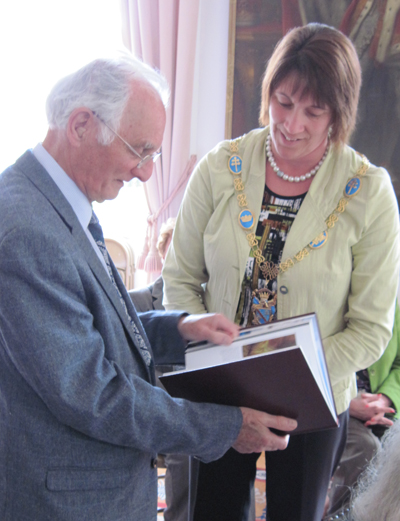 The Mayor presents Sir John with a history of Armagh